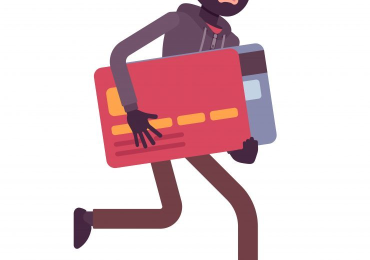Thief in a black mask stole credit card and is running away